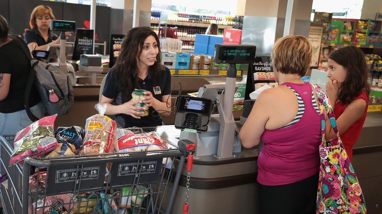 Aldi cashier at the till