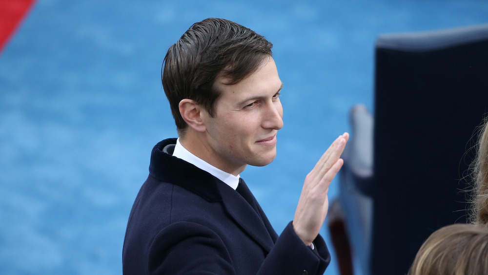 Jared Kushner in navy coat