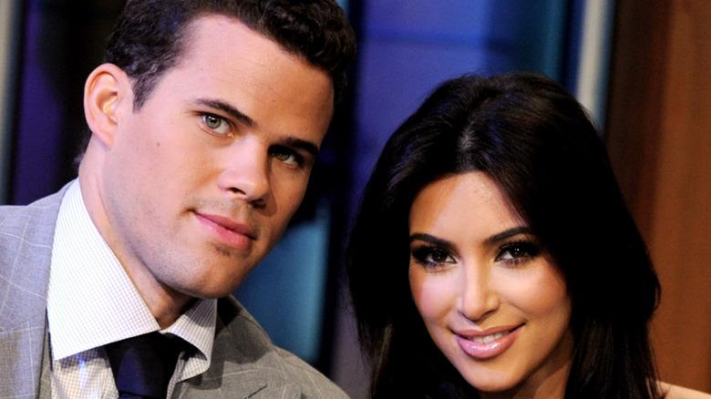 Kim Kardashian and Kris Humphries pose for the camera.