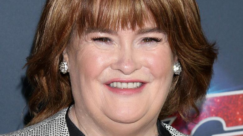 Susan Boyle smiling with bangs