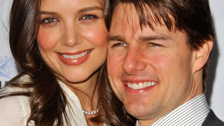 Katie Holmes and Tom Cruise posing on the red carpet