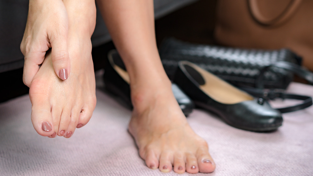 Person suffering from sore feet