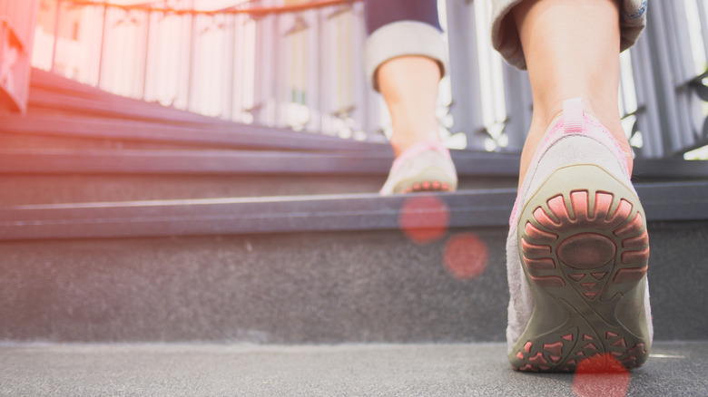 Woman running stairs in sneakers