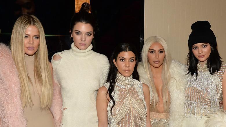 Khloe Kardashian, Kendall Jenner, Kourtney Kardashian, Kim Kardashian and Kylie Jenner posing together at an event