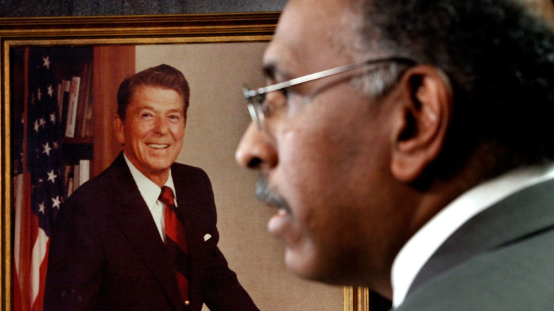 former RNC Chair Michael Steele against the photo of Ronald Reagan