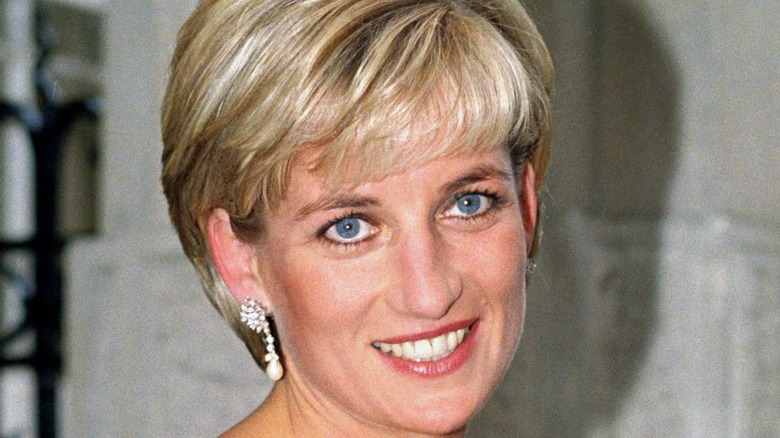 Princess Diana smiling while having her picture taken