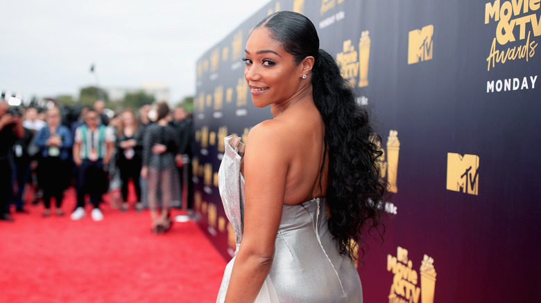 Tiffany Haddish looks over her shoulder on the red carpet