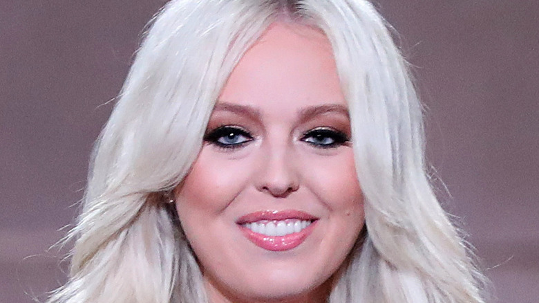 Tiffany Trump smiles with glossed lips.