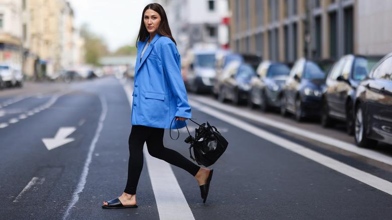 Woman walking down the street in sandals