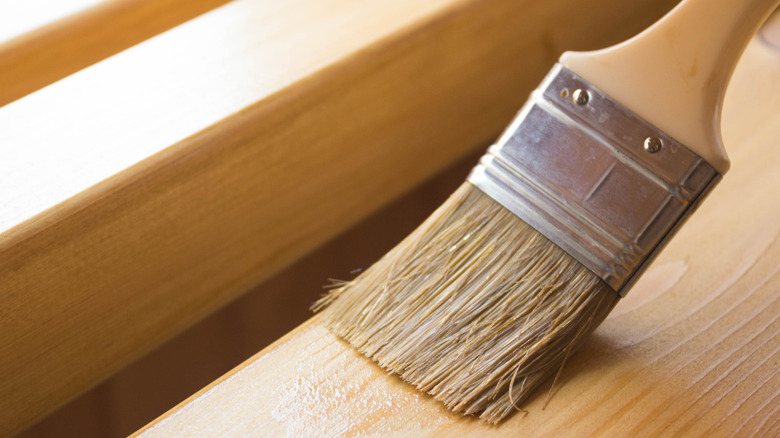 A paint brush polishing wood