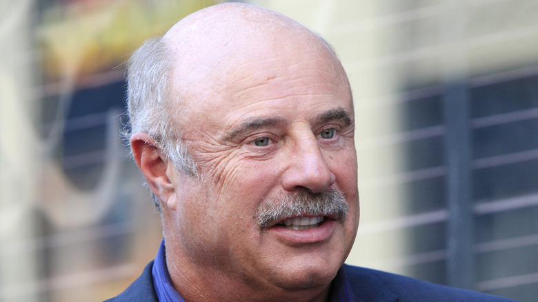 Dr. Phil attending an event