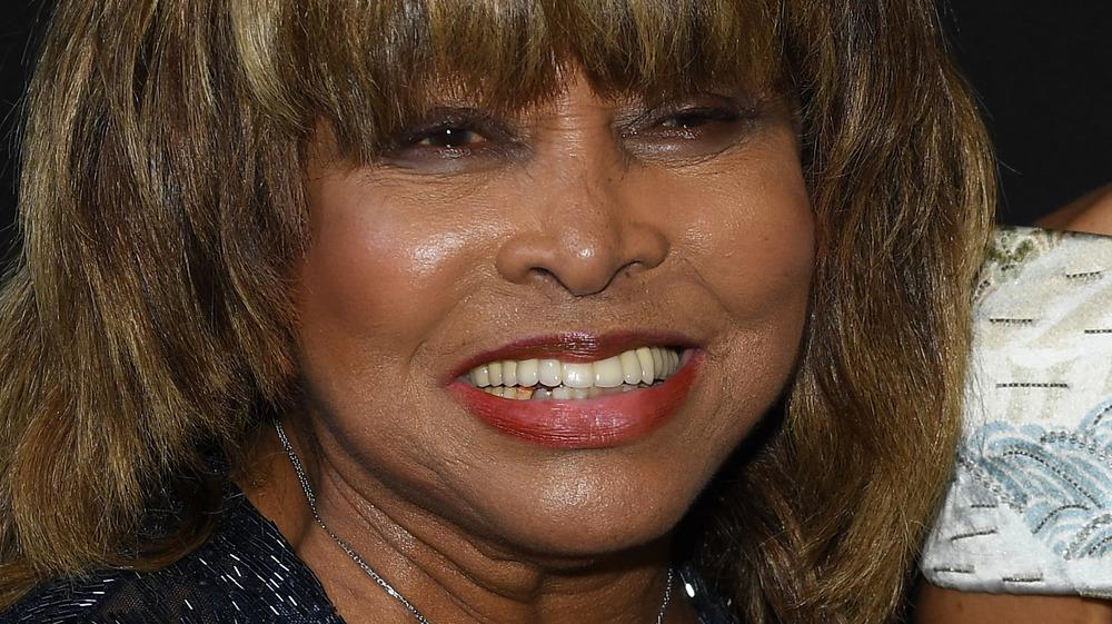 Tina Turner smiling with bangs