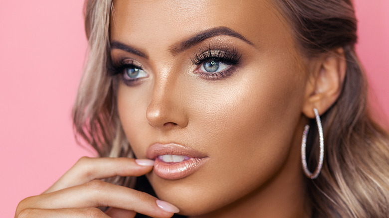 Woman wearing glitter lip gloss