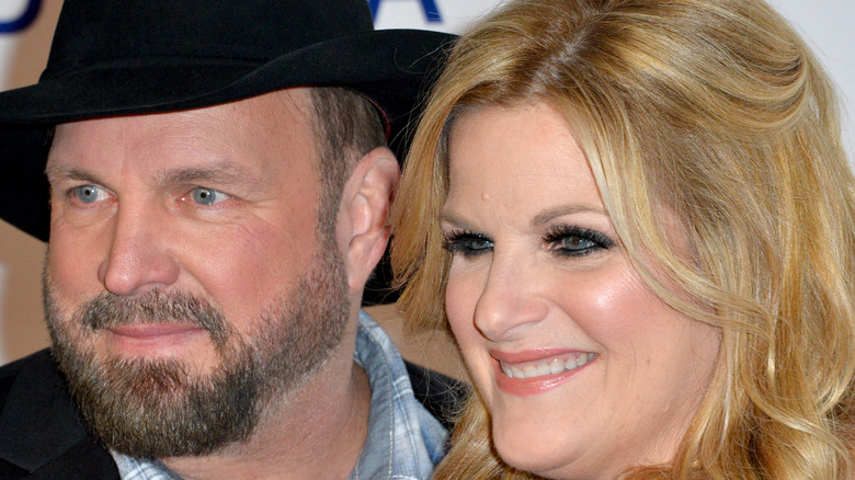 Trisha Yearwood and Garth Brooks smile together