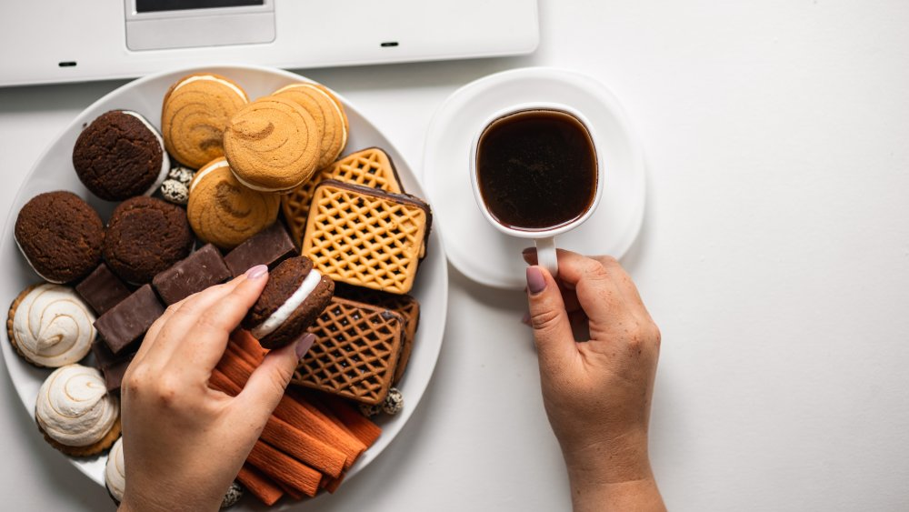 eating a plate of cookies in front of the computer, stress-eating