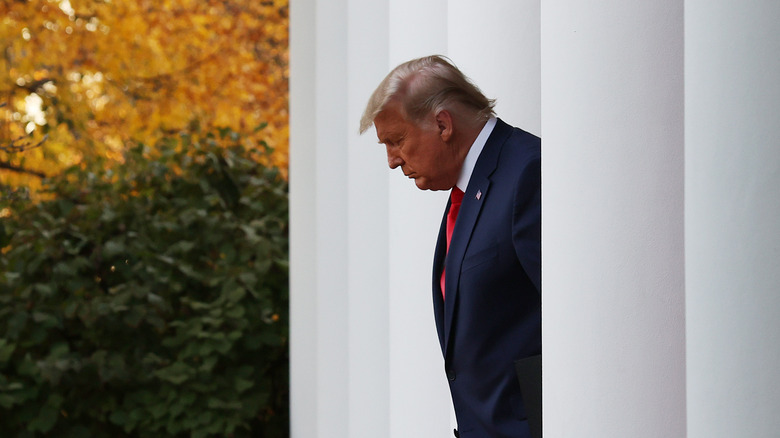 Trump walking to a press conference