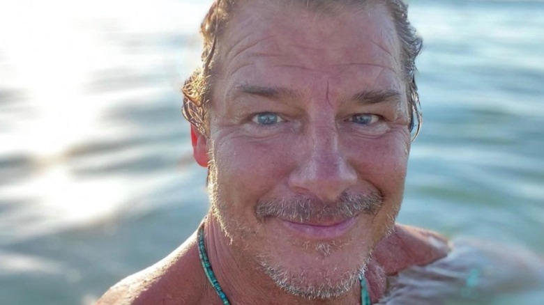 Ty Pennington taking a selfie while swimming