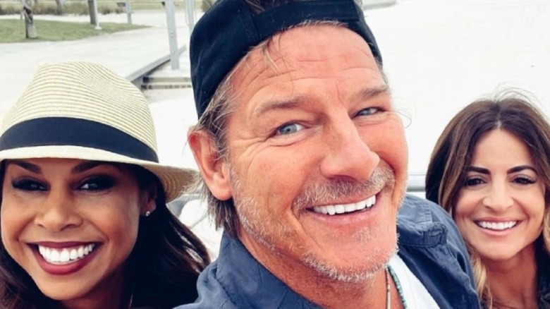 Ty Pennington smiling with two women