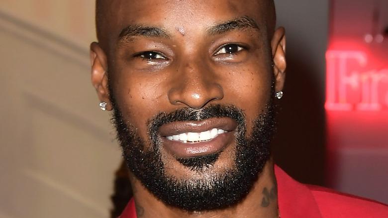 Tyson Beckford smiles with a beard.
