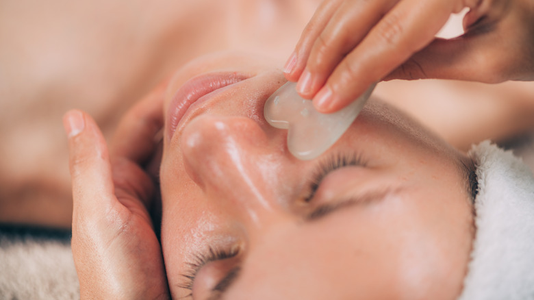 Gua sha tool being used