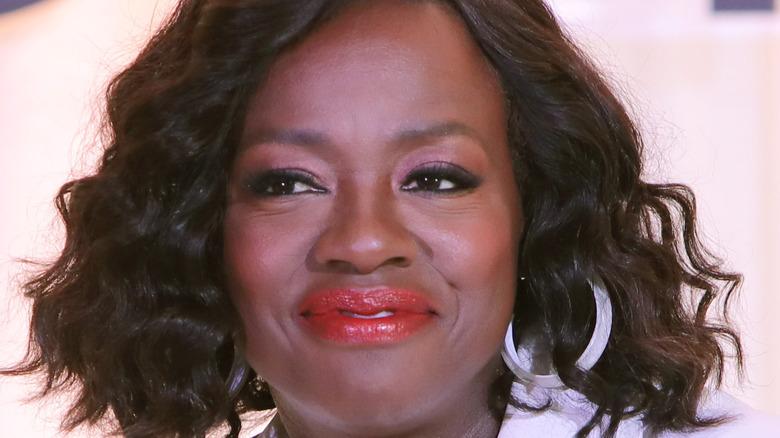 Viola Davis smiling with hoop earrings