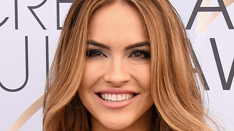 Chrishell Stause poses on the red carpet