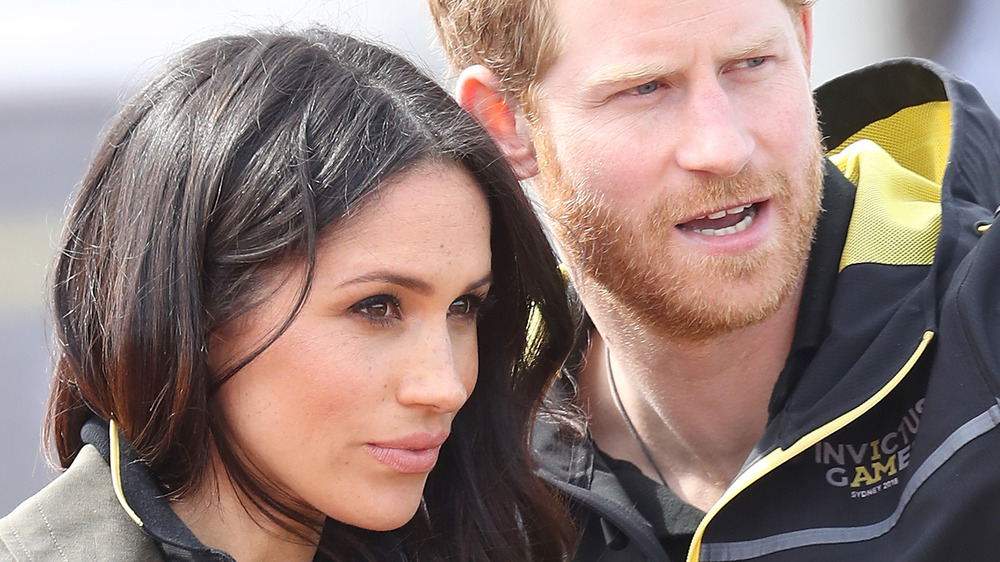 Meghan and Harry looking off-camera