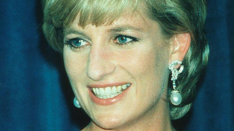 Princess Diana smiling in pearl drop earrings