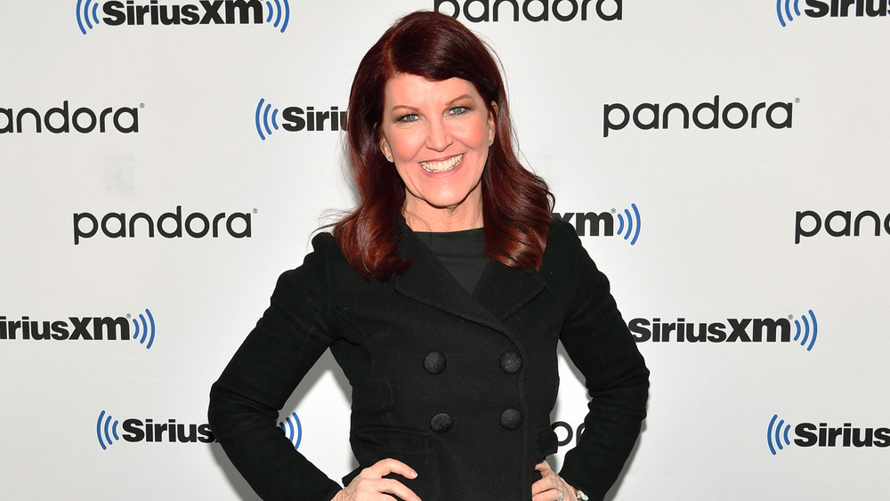 Kate Flannery smiling in black coat