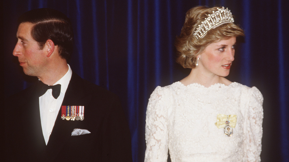 Prince Charles and Princess Diana facing away from each other