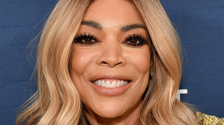 Wendy Williams smiling with blonde hair