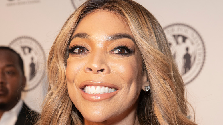 Wendy Williams smiles on the red carpet