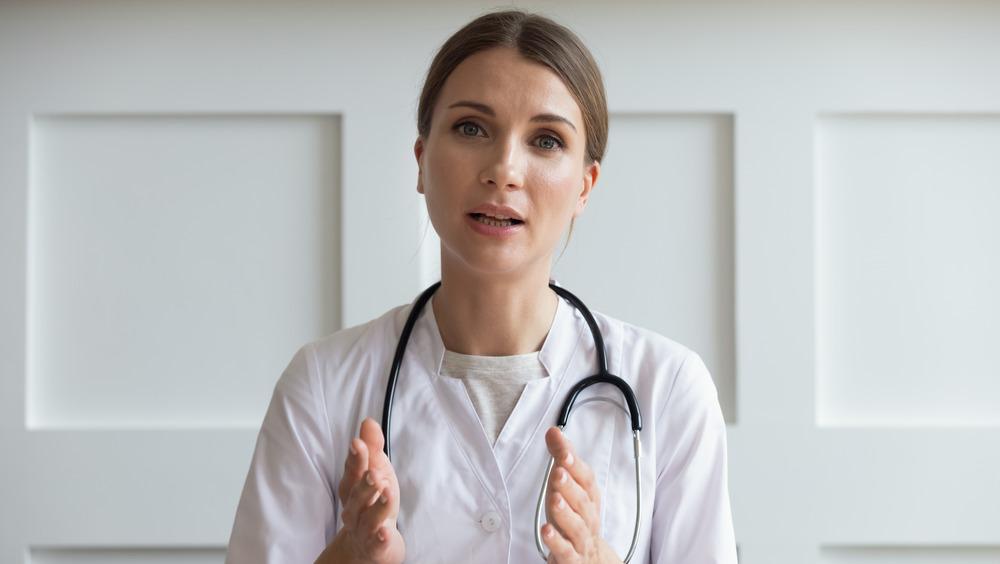 Doctor with stethoscope around neck