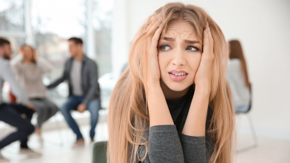 Woman anxious around others