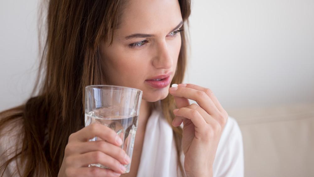 Woman taking keto diet pills