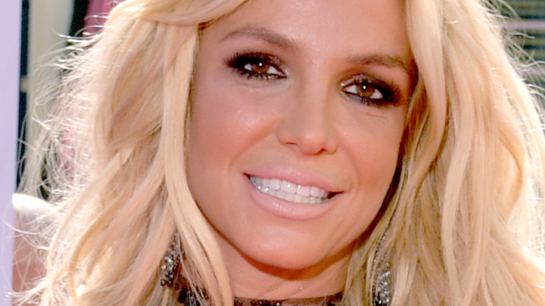 Britney Spears smiling for cameras