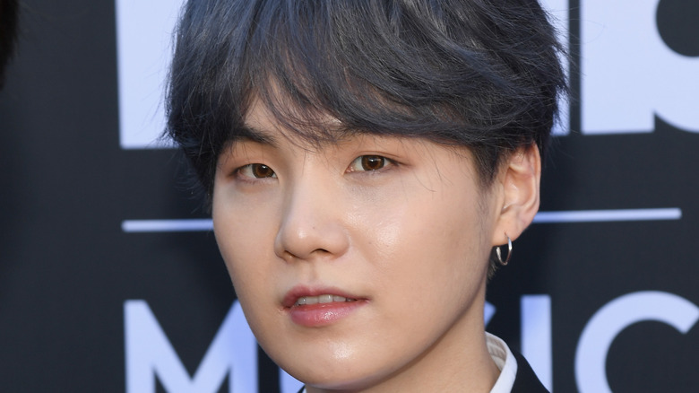 Suga of BTS attends an event