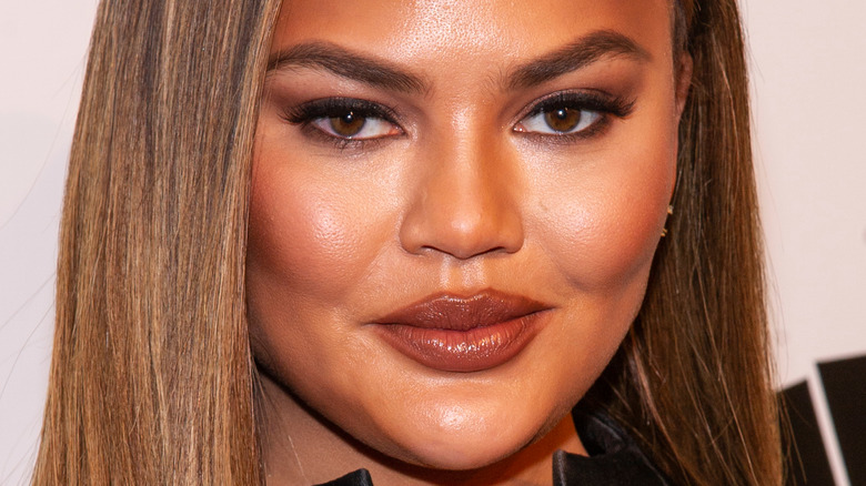 Chrissy Teigen with makeup on