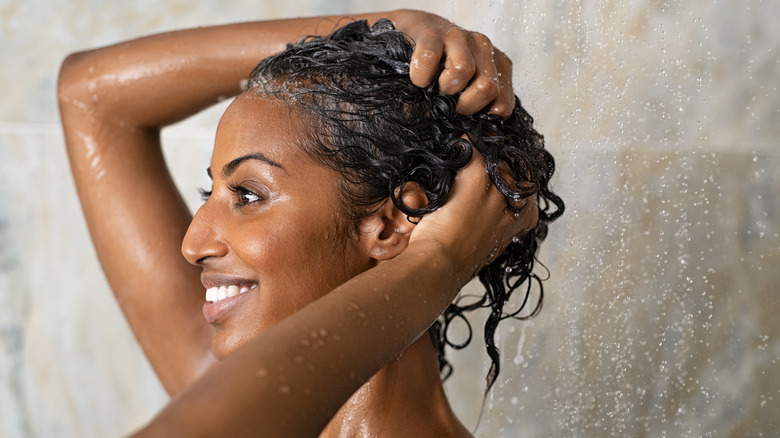 woman hair conditioner in shower
