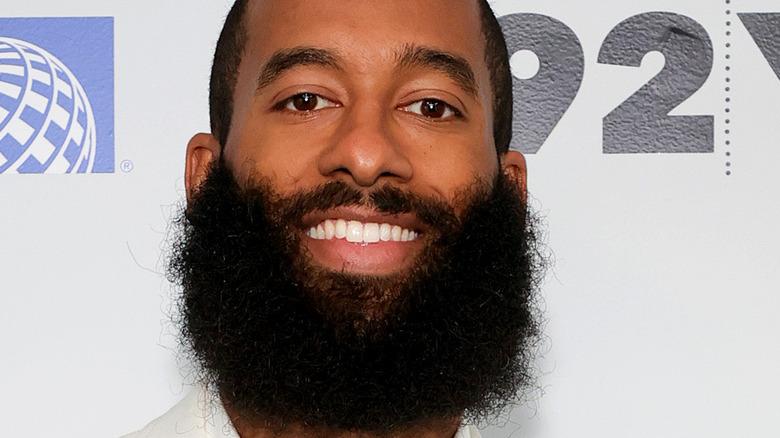 A bearded Matt James smiling at an event