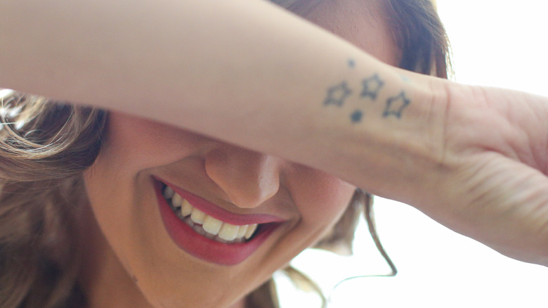 Woman with star tattoos smiling