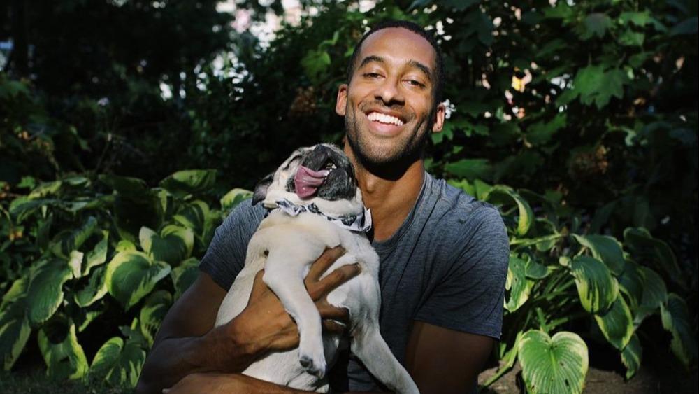 Bachelor Matt James poses with his adorable pug