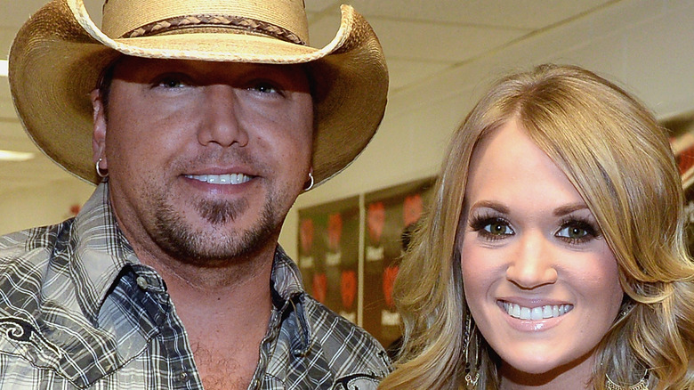 Carrie Underwood and Jason Aldean pose backstage