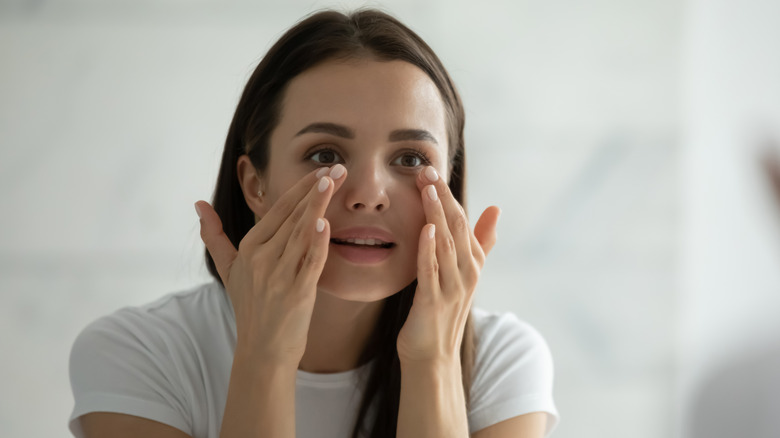 Woman practicing skin care