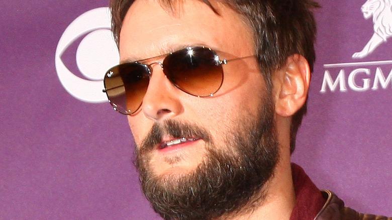 Eric Church posing in sunglasses with facial hair