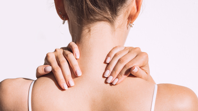 Woman experiencing pain in her neck