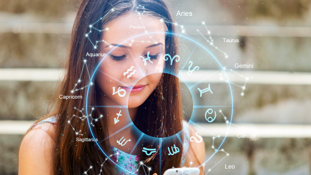 Woman with zodiac chart