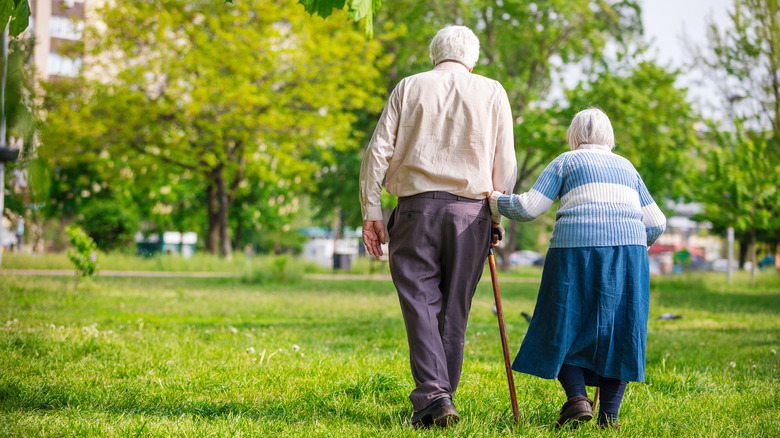 Elderly couple with dowager's hump