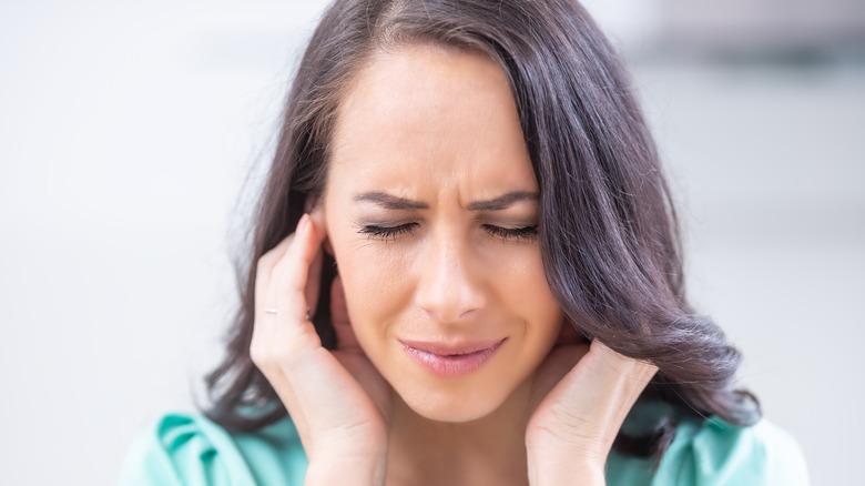 Woman's ear burning