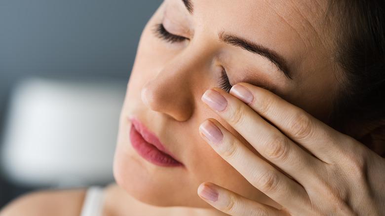 Woman experiencing pain in her eye